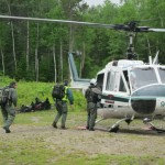 BSP rangers load a rescue chopper in preparation for flight.